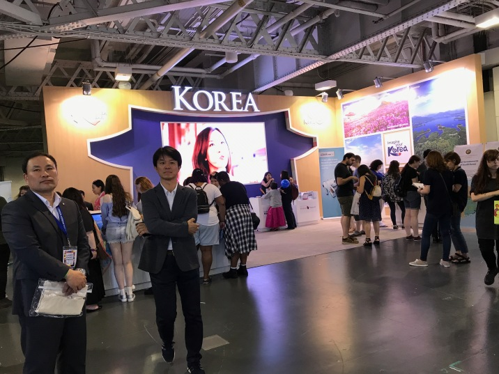 Director Hoseong Yong of KCCUKin front of the Korea Tourism Pavilion